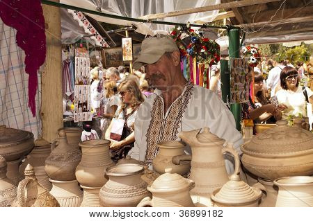 Sorochinskaya Fair. Potter Sells Pottery.