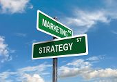 stock photo of marketing plan  - Marketing Strategy signs on clear blue sky - JPG