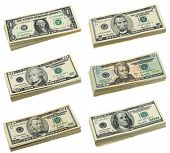 stock photo of money stack  - Stacks of US dollar bills in isolated white background - JPG