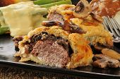 stock photo of beef wellington  - Close up of Beef Wellington with asparagus and mashed potatoes - JPG