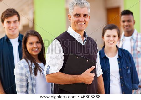 portrait of smiling high school teacher and students