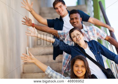 playful group of cheerful teenage high school students