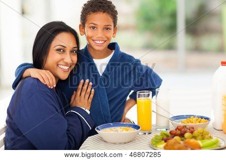 beautiful indian mother and son at breakfast table