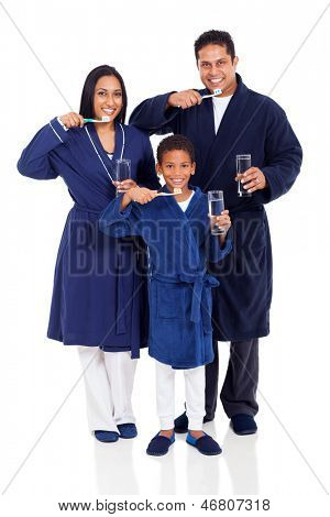 cute indian family in pajamas brushing teeth on white background