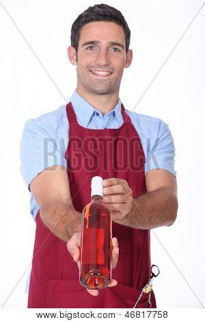 Waiter offering bottle of wine