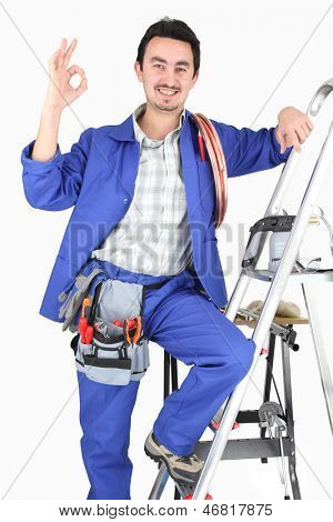 Man with ladder and plumbing tools
