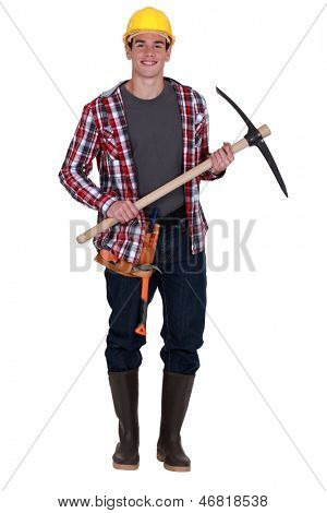 Smiling  workman with pickaxe