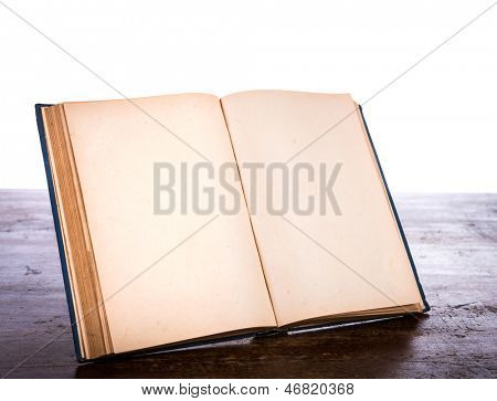 Open old vintage book on wooden table