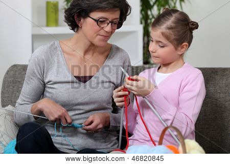 Mother and daughter knitting