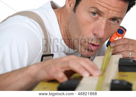Man measuring piece wood