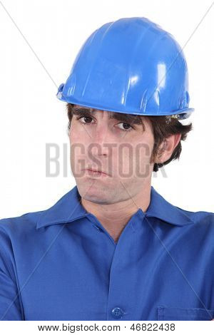 head-and-shoulders portrait of craftsman looking exasperated