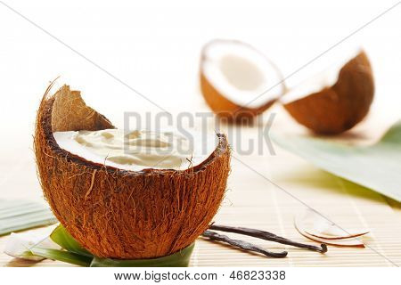 Coconut mousse dessert with coconuts and vanilla beans
