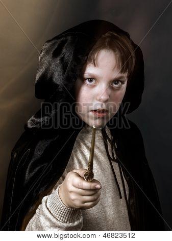 Portrait Of Teenage Boy Dressed In Wizard Costume