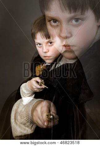 Portrait Of Teenage Boy Dressed In Wizard Costume
