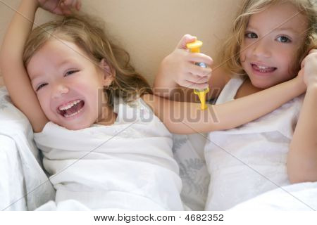 Two Little Twin Sisters, Play Doctors With Syringe