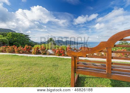 Empty Wooden Bench With A Beautiful View Of Sea, Sky And Hills.