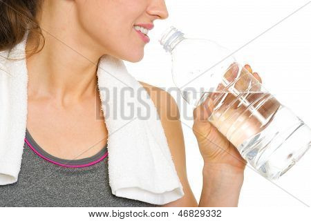Closeup On Young Woman Drinking Water