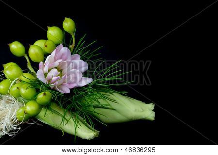 Corsage with pink daisy