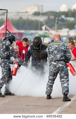 MOSCOW - AUG 25: Rescue workers extinguish a stunt man after ignition on Festival of art and film stunt Prometheus in Tushino on August 25, 2012 in Moscow, Russia. The festival was organized in 1998.