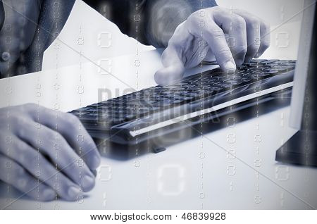 Man Working At A Computer Keyboard