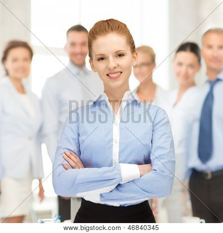bright picture of happy and smiling woman in office