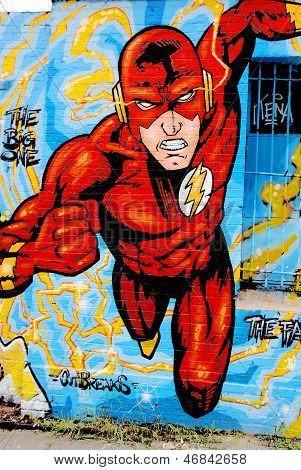 Street art mural of Flash supehero