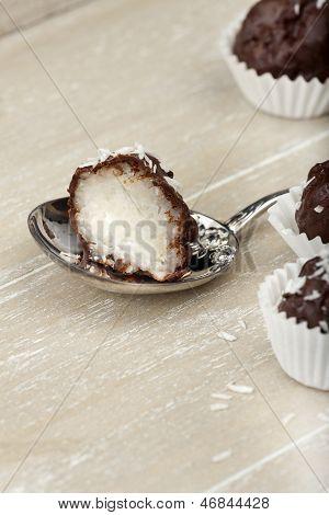 Coconut Milk Rice Truffles On A Silver Spoon
