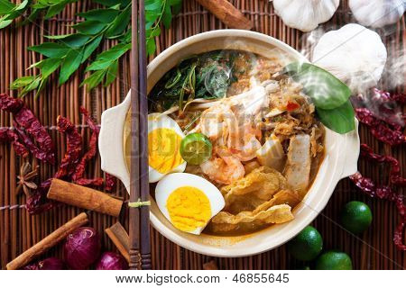 Prawn mee, prawn noodles. Popular Malaysian food spicy fresh cooked har mee in clay pot with hot steam. Asian cuisine.