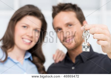 Happy Couple Owner Of New House With Keys