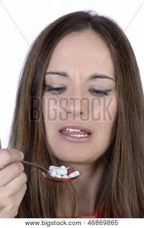 Pretty Woman With Spoon Of Pills