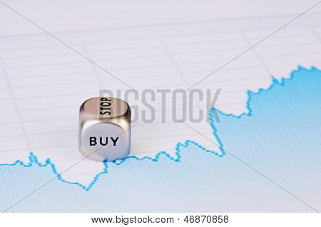 Uptrend Financial Chart And Dice Cube With The Word Buy. Selective Focus