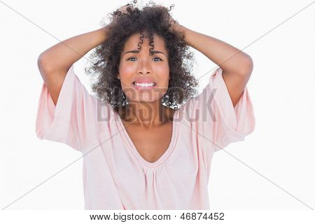 Stressed woman pulling her hair on white background