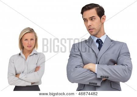 Business people standing together showing rivalry on white background