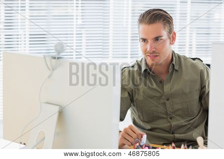 Creative business employee having webcam videocall in a modern office