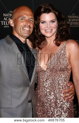 LOS ANGELES - JUN 16:  James Achor, Heather Tom arrives at the 40th Daytime Emmy Awards at the Skirball Cultural Center on June 16, 2013 in Los Angeles, CA
