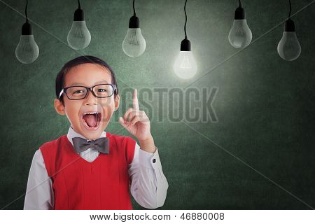 Asian Boy Has Idea Under Light Bulb In Class