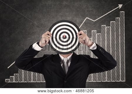 Businessman And A Dart In Bull's Eye