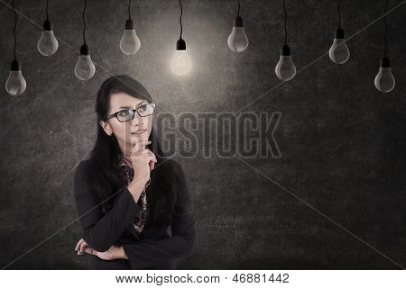 Businesswoman And Lamps, Symbol Of Idea
