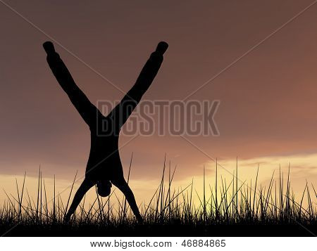 Concept or conceptual human male or young man black silhouette playing happy in summer grass over sky at sunset or sunrise background