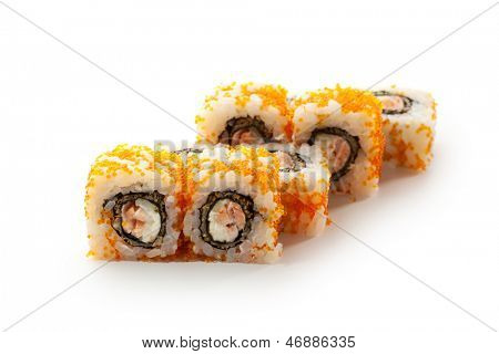 Japanese Cuisine - Sushi Roll with Deep Fried Salmon, Cucumber and Philadelphia Cheese insisde. Tobiko outside