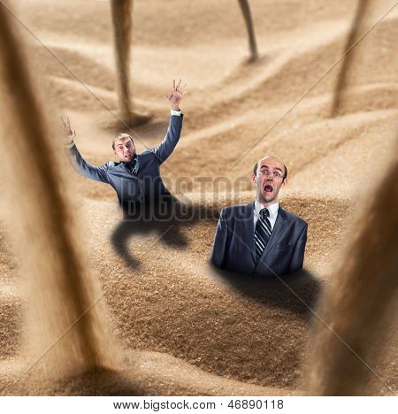 Two businessmen fall into the quicksand trap