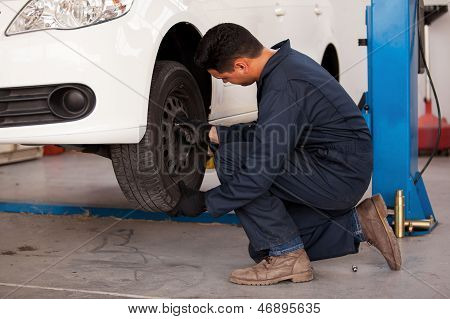 Rotating tires at an auto shop