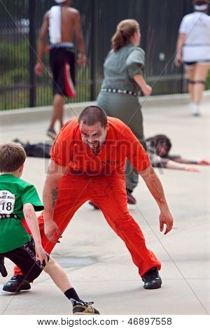 Monster Tries To Catch Kid Running In Atlanta Zombie Run