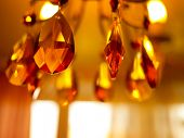Chrystal golden yellow chandelier close-up. Shallow DOF.