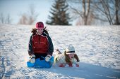 image of sleigh ride  - two girls going down tobogganing hill looking scared - JPG