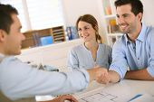 image of draft  - Young couple meeting construction planner - JPG