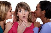 stock photo of threesome  - trio of female gossips - JPG