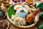 Nasi kerabu or nasi ulam, popular Malay rice dish. Blue color of rice resulting from the petals of