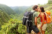 stock photo of hawaiian girl  - Couple in love kissing while hiking on Hawaii - JPG