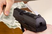 stock photo of glock  - Robbery with the use of a gun in the office - JPG